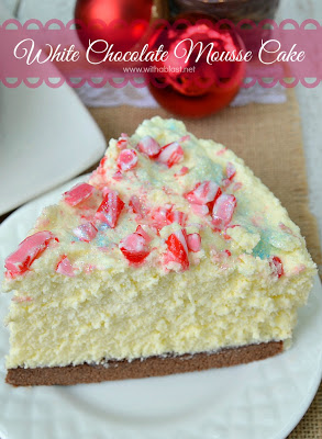 White Chocolate Mousse Cake ~ The BEST mousse cake EVER ! With a chewy Cake base, creamy Mousse and a taste which will blow you away ~ this is also a make-ahead recipe and yields 12 - 16 slices ,,, perfect for Christmas #MousseCake #Christmas www.withablast.net