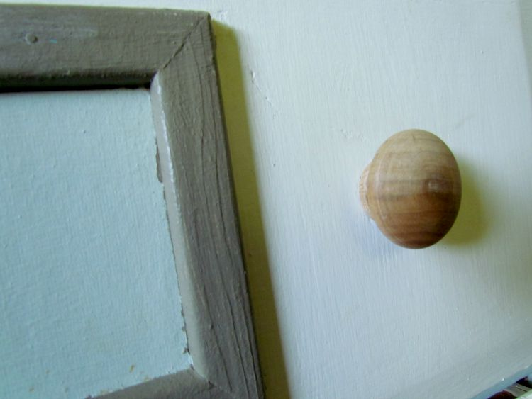 wooden knobs make the piece feel unfinished