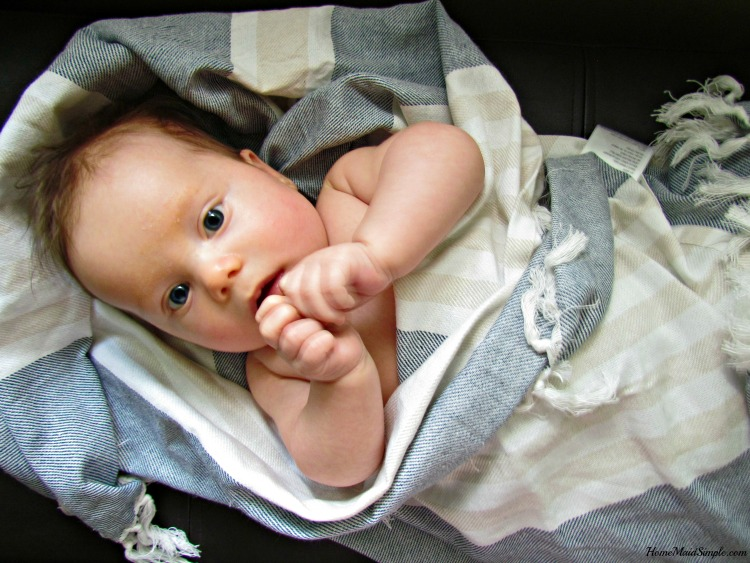 Lulujo Baby Turkish Towel from The Baby Cubby helps comfort baby after their bath. ad