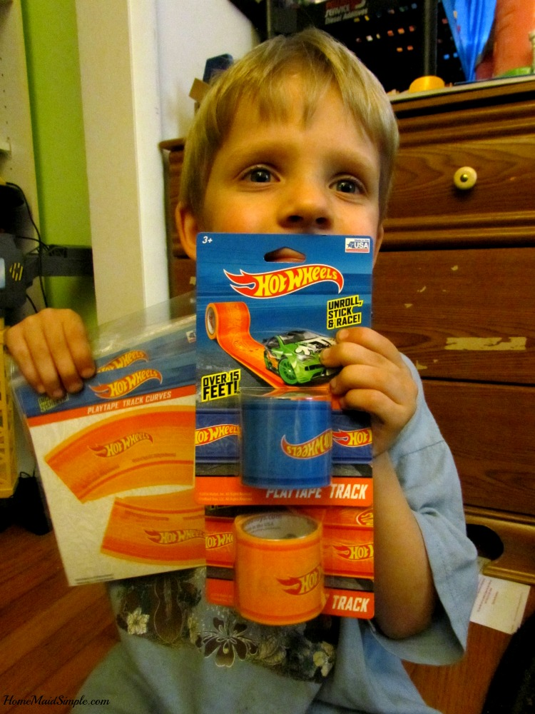 Hot Wheels® PlayTape® makes play time more fun. ad