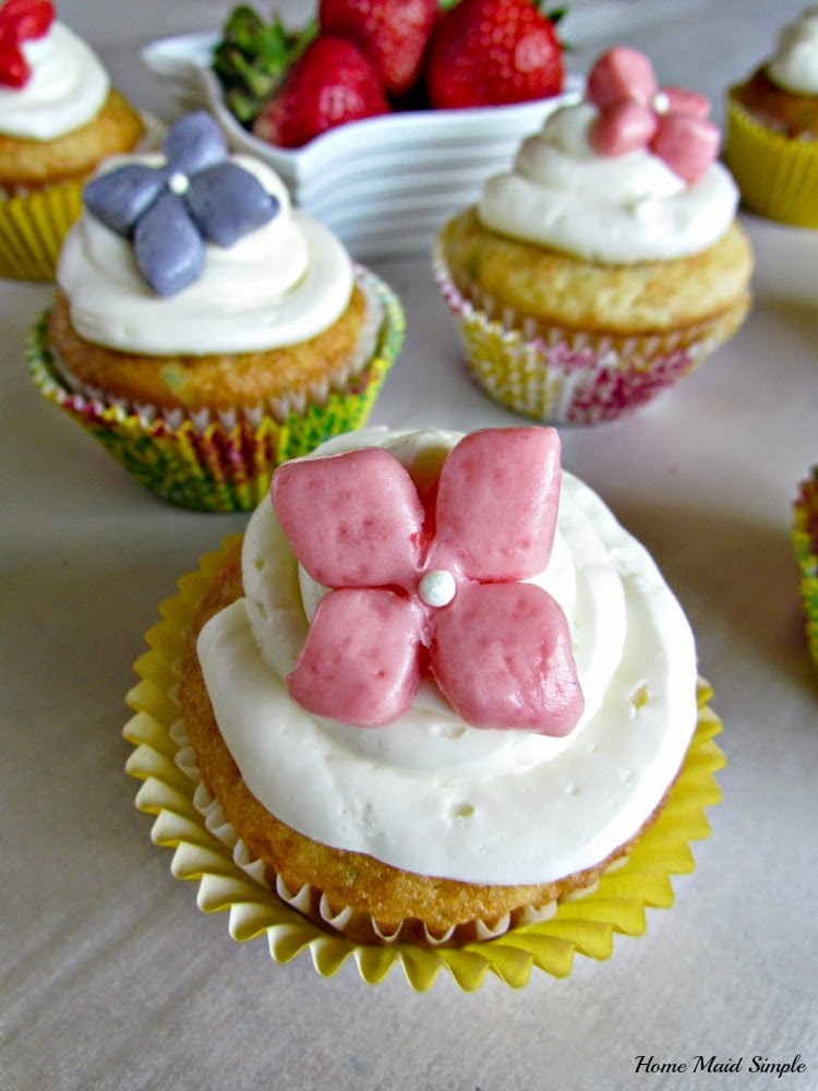 Vanilla Cupcakes with Strawberry Curd Filling and a Starburst Flower